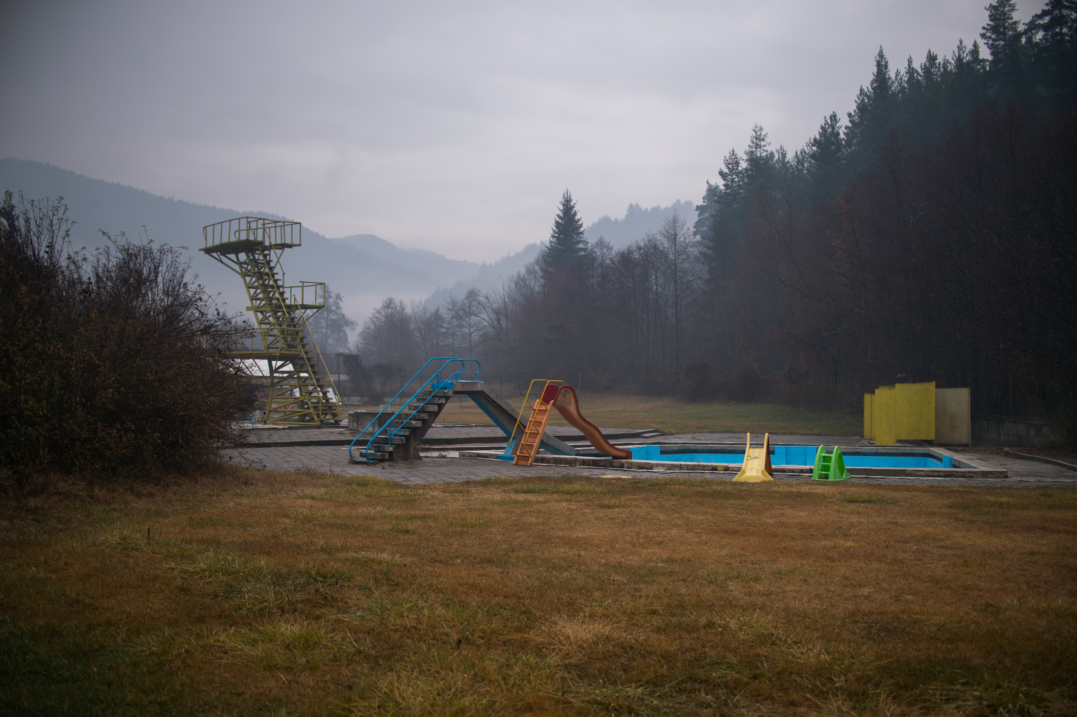 A general view of an abandoned mineral water pool with playground in the village of Eleshnitsa on December 4, 2020. NIKOLAY DOYCHINOV for AufRuhr