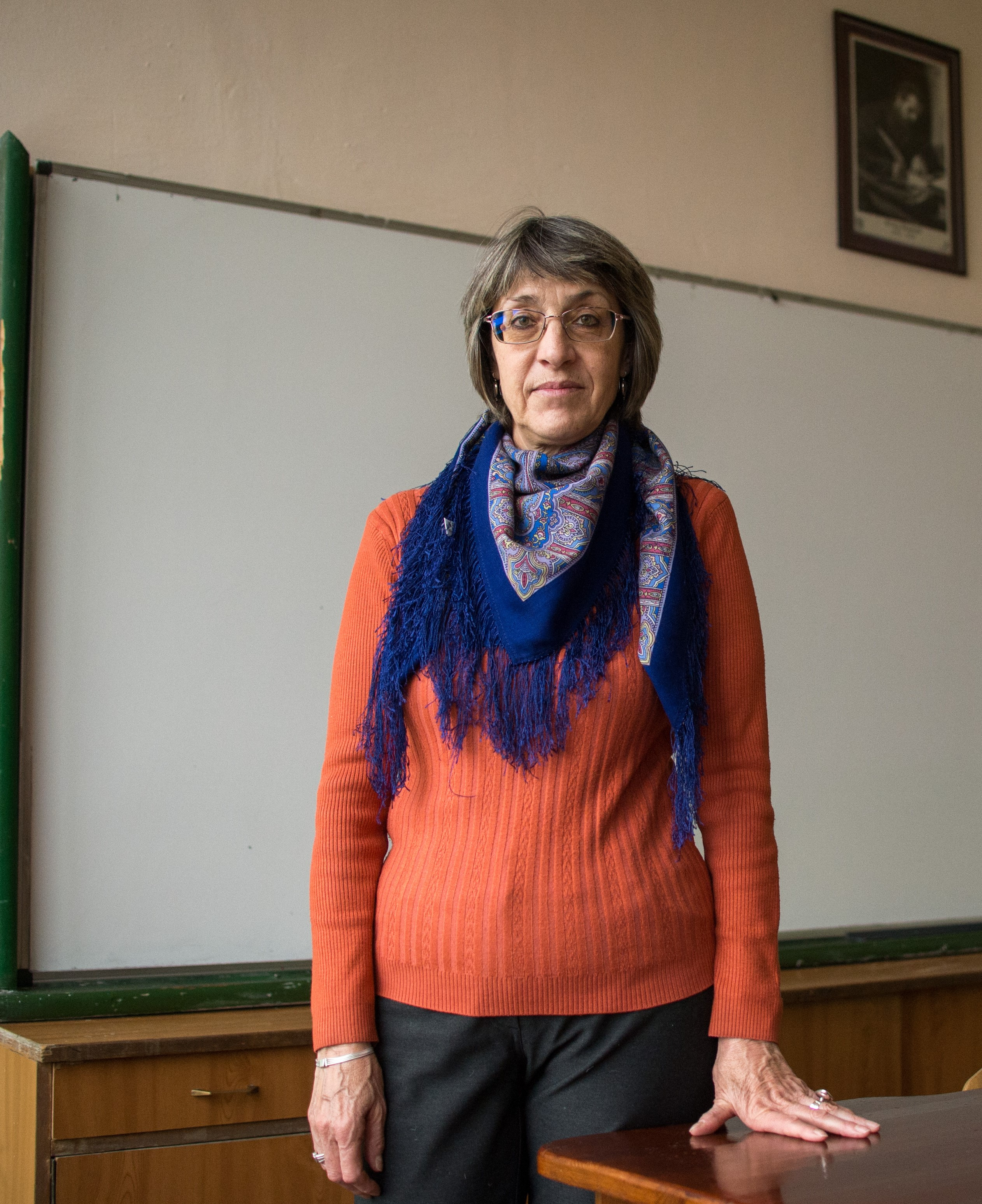 """Katya Brankova, teacher, posses for a photo in her classroom at the Secondary school """"Brothers Peter and Ivan Kanazirevi"""" in the town of Razlog on December 4, 2020. NIKOLAY DOYCHINOV for AufRuhr"""